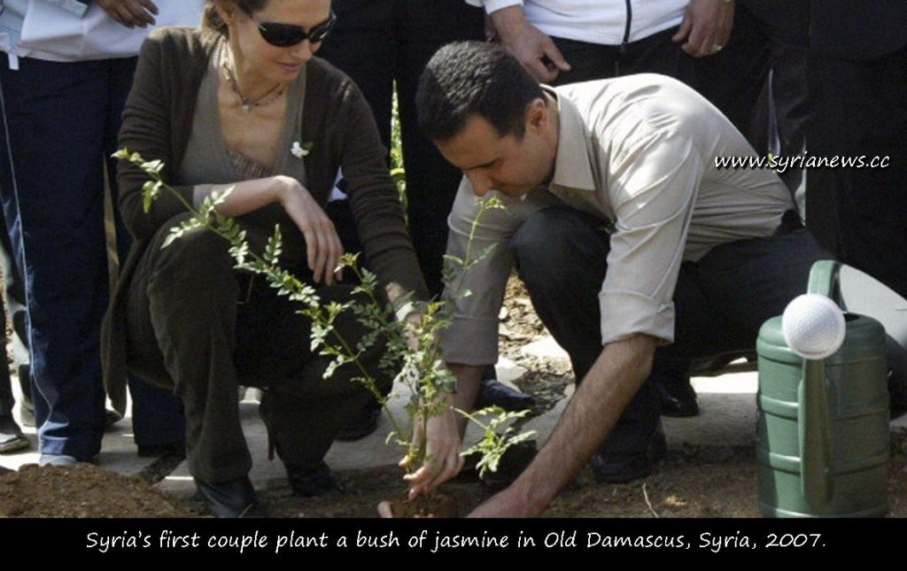 Asmaa & Bashar Al Assad Plant a Jasmine bush in Damascus in Old Damascus, 2007