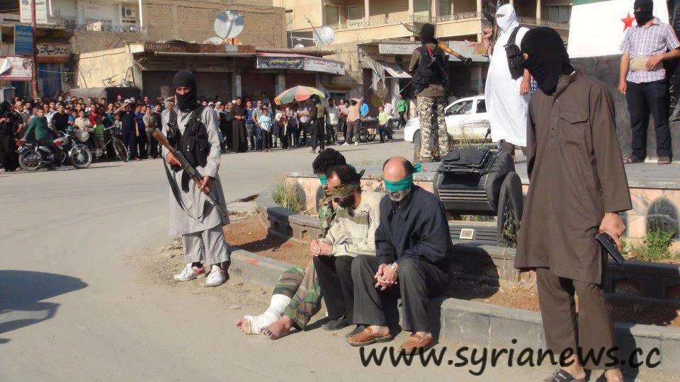Obama's Nusra Front execute 3 men in a public square