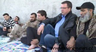 Vadim Fefilow (NTV) between jihadists in Aleppo.