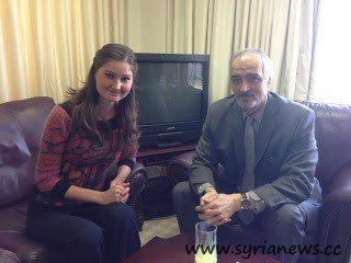 Anastasia Popova with Bashar Jaafari, the Syrian ambassador to the UN.