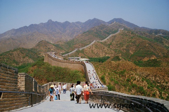 Visitors Walk Along the Great Wall