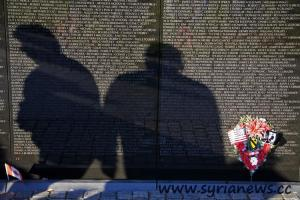 Shadow of men on the Vietnam War Memorial, Washington DC