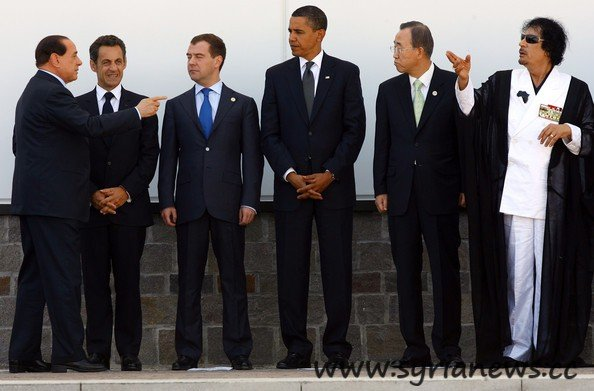 Gaddafi with Ban Ki-moon, Obama, Medvedev, Berlusconi and Sarkozy.