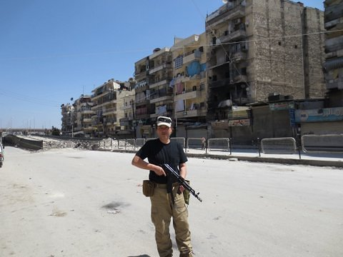 Yukawa's Facebook wall is littered with photos of him, AK-47 in hands, proudly posing before bombed-out buildings in Aleppo, Syria's second largest city.