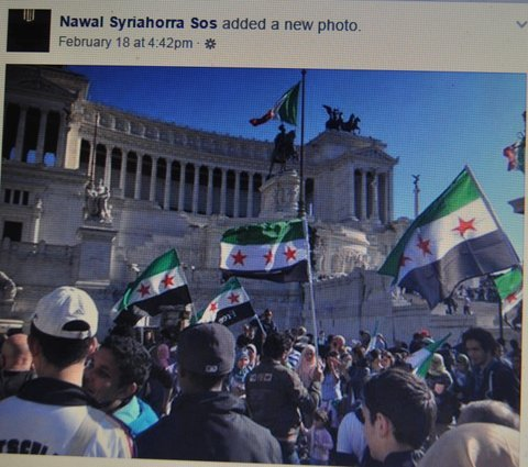"Takfiri supporters with the flag of French Mandate occupation of Syria. It is fitting they stand at the feet of Piazza Vittorio Emmanuele. Built to celebrate the unification of Italy (1870), its few kings claimed ownership of Ethiopia, and Albania, and cut a deal with the Blackshirts, to make fascist Benito Mussolini the Dictator-Prime Minister of Italy. The country stopped recognizing 'royal blood,' in 1947. Of peculiarity, Wiki now calls the battle between the partigiani, and the fascists, a ""civil war."""