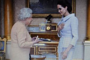 "Jolie being Dam[n]ed by Queen parasite ""for services to United Kingdom foreign policy."""