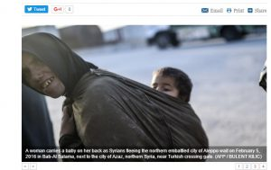 Does this look like a Syrian woman seeking refugee in Turkey, with her child?