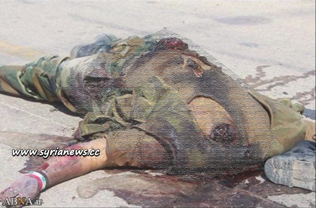 image-decapitated body of slain Syrian soldier Blurred