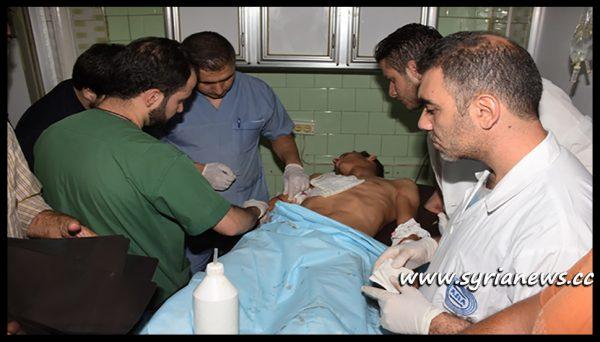 image-Injured civilians in the rebels shelling of Akramiya neighborhood in Aleppo