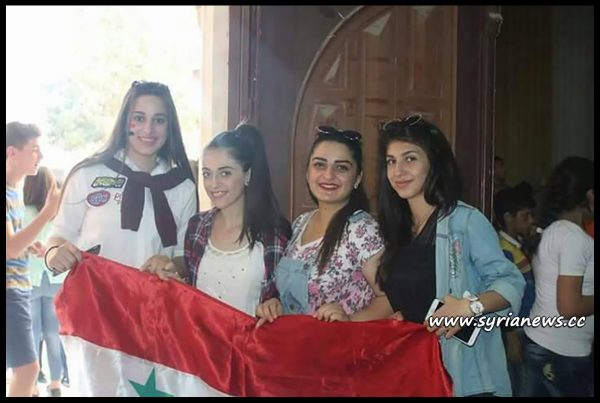 image-Beautiful young Syrian ladies carrying the real Syrian Flag
