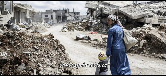 Syrian woman with her child in the rubble Damascus, Aleppo, Der Ezzor, Raqqa, Daraa, Sweida, Idlib, Hama, Homs